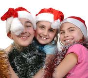 庆祝圣诞节的小组愉快的朋友 库存照片