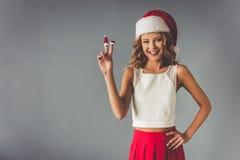 庆祝圣诞节的美丽的妇女 库存图片