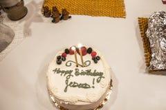 庆祝圣诞节的耶稣的生日蛋糕 库存图片