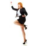 庆祝在工作的女孩优胜者成功 免版税库存照片