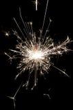 庆祝在黑背景的党闪烁发光物小的烟花 圣诞节的用途和新年和其他庆祝 免版税图库摄影