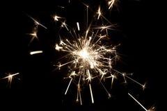 庆祝在黑背景的党闪烁发光物小的烟花 免版税库存图片