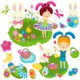 庆祝复活节的愉快的孩子 免版税库存照片