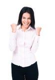 庆祝她的优胜者的愉快的女实业家 库存照片