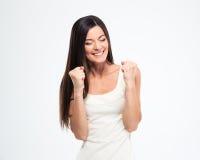 庆祝她的成功的微笑的妇女 免版税库存照片