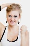 庆祝成功手势的白肤金发的女孩优胜者 免版税图库摄影