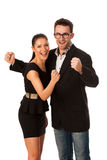 庆祝成功的企业夫妇握拳头和尖叫 免版税库存照片