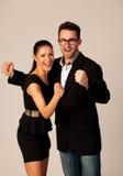 庆祝成功的企业夫妇握拳头和尖叫 图库摄影