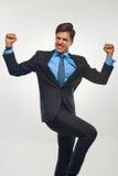 庆祝成功的商人反对白色背景 免版税库存图片