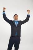 庆祝成功的商人反对白色背景 免版税图库摄影