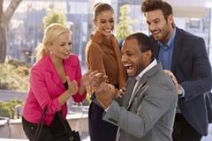庆祝成功的愉快的businessteam 免版税库存图片