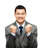 庆祝成功的混合的族种商人隔绝在白色bac 免版税库存图片