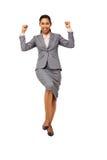 庆祝成功的激动的女实业家 免版税库存图片
