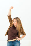 庆祝成功的激动的少妇 免版税库存照片