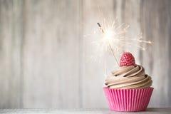 庆祝杯形蛋糕 免版税库存照片
