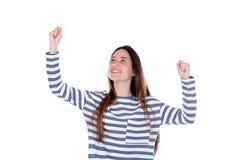 庆祝某事的愉快的少年女孩留下她的手 库存照片