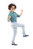 庆祝某事的愉快的非裔美国人的十几岁的女孩 免版税库存图片