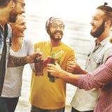 庆祝欢呼一起喝朋友概念的行家 库存图片