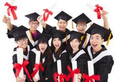 庆祝毕业的小组学生 免版税库存图片