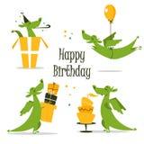 庆祝生日的逗人喜爱的龙 免版税库存照片