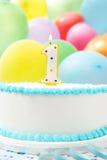 庆祝第1个生日的蛋糕 库存照片