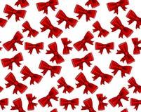 庆祝红色弓无缝的背景。 免版税库存照片