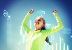 庆祝胜利的妇女赛跑者 图库摄影