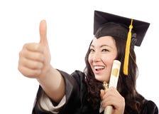 庆祝获得她的文凭 免版税库存图片
