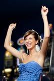 庆祝赢取的迷人的妇女 免版税库存图片