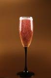 庆祝香槟嘶嘶响粉红色 库存照片