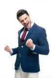 庆祝他的成功的愉快的商人 库存照片