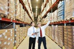 仓库乘员组在工作 免版税库存图片