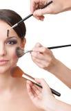 应用在妇女的表面的三个现有量化妆用品 免版税库存照片