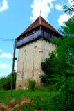 废墟 被加强的中世纪撒克逊人的福音派教会在村庄Cobor,特兰西瓦尼亚,罗马尼亚 库存照片