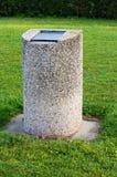 废物箱在公园 免版税库存图片