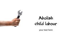 废除童工!有板钳的肮脏的儿童手 免版税图库摄影