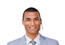 座席客户服务部微笑的年轻人 免版税库存图片