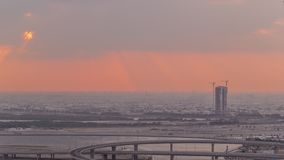 建筑和交叉点在迪拜Creek港口空中timelapse附近在日出期间 迪拜-阿拉伯联合酋长国 影视素材