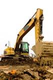 建筑坏的挖掘机停放的站点 库存图片