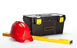 建筑安全帽级别红色工具箱 免版税库存图片