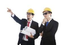 建筑师他的合作伙伴 免版税库存图片