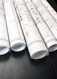 建筑师卷和计划图纸庄园 免版税库存照片