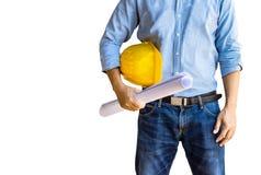 建筑师和黄色安全帽在白色背景与裁减路线,被隔绝 库存照片