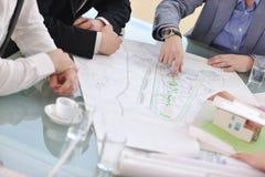 建筑师在会议的企业小组 免版税库存照片
