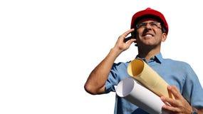 建筑师或工程师有智能手机的被隔绝在白色背景 免版税库存图片
