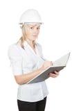 建筑师美丽的工程师女孩注意作为 免版税库存图片