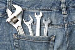 建筑牛仔裤口袋工具 顶视图 免版税库存图片