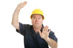 建筑被困住的工作者 免版税库存图片
