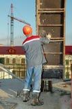 建造者模板安装 库存图片