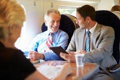 开两个的商人关于火车的会议 图库摄影